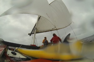 GoPro frame of the bamboo-polytarp crab full on a close reach from the leeward side.